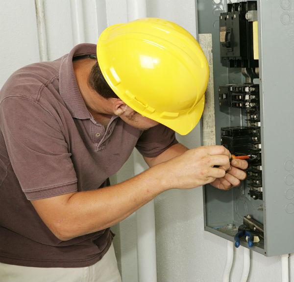 Orange County Electrician Fixing A Breaker